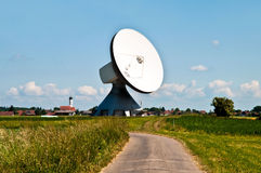Parabolic antenna and town Stock Image