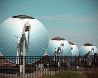 Parabolic dish solar energy collector. Mirrored parabolic solar dish solar collector stock images