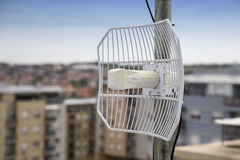 Parabolic grid antenna on apartment building 2 Stock Photography