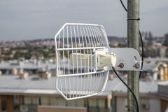 Parabolic grid antenna on apartment building 4 Stock Photography