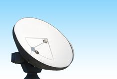 Parabolic reflector antenna. A parabolic reflector antenna is  against a blue background Royalty Free Stock Photos