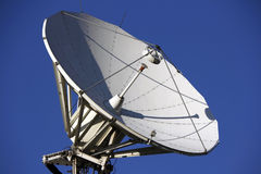 Parabolic satellite dish. A satellite dish with blue sky in a sunny and nice day Stock Image