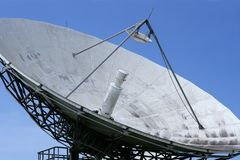 Parabolic satellite dish receiver over blue sky Stock Images