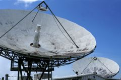 Parabolic satellite dish receiver over blue sky Stock Photography