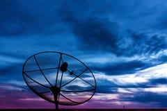 Parabolic satellite dish in twilight Royalty Free Stock Images