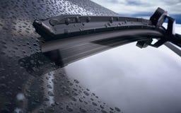 Parabrisas del coche con gotas de lluvia y el primer frameless de la cuchilla de limpiador ilustración del vector