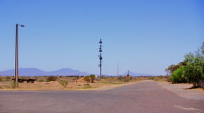 Parachilna Crossroads. Photograph of an outback urban scene, taken on the fringe of the township of Parachilna featuring powerlines, a communications tower, and royalty free stock photography