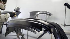 Parachoques trasero de pintura del coche en negro almacen de video