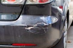 Parachoques trasero negro de la abolladura del coche foto de archivo libre de regalías