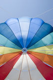 Parachute. A colourful parachute in the sky Royalty Free Stock Image