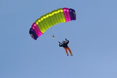 Parachute. Colorful parachute against blue sky Royalty Free Stock Photo