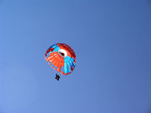Parachute. Colored parachute in the sky Stock Images