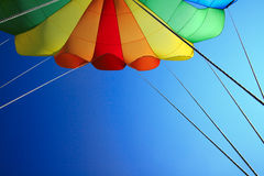 Parachute. Large and colorful parachute against blue sky Royalty Free Stock Photos