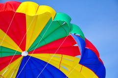 Parachute. The colorful stripes of parachute in the sky Stock Photo