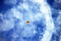 Parachute. A man in a parachute coming down from a great height Royalty Free Stock Photos