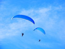 Parachute. Flying In The Blue Sky Royalty Free Stock Photo