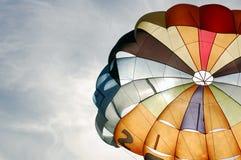 Parachute. Colorful parachute against blue sky stock photo