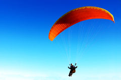 Parachute against clear sky. Red parachute against clear sky in background Stock Images