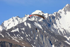 Parachute against white mountains in the Pyrenees Royalty Free Stock Images