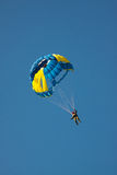 Parachute on background blue sky. Royalty Free Stock Photos