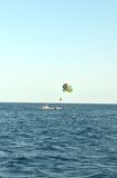 Parachute on blue sea Stock Images
