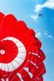 Parachute on blue sky. Parachute and airplane on blue sky Stock Images