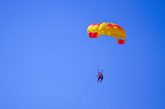 Parachute in the blue sky Stock Images