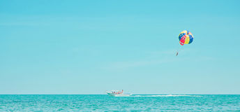 Parachute and boat in sea Royalty Free Stock Image