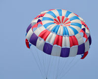 Parachute. A colorful parachute with blue summer sky in the background stock photography