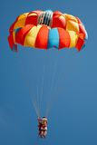 Parachute with a couple flying Stock Images