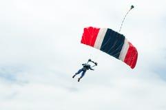 Parachute descending Stock Images