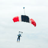 Parachute descending Royalty Free Stock Images