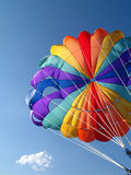 Parachute detail. A colorful parachute with blue summer sky in the background Royalty Free Stock Images