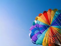 Parachute detail. A colorful parachute with blue summer sky in the background Royalty Free Stock Image