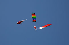 Parachute display team performs before cricket festival at Isa Town, Bahr Stock Photo