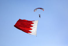 Parachute display team performs before cricket festival at Isa Town, Bahr Royalty Free Stock Image