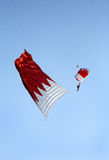 Parachute display team performs before cricket festival at Isa Town, Bahr Stock Images