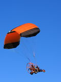 Parachute with engine. Parachute or paraglider in the blue sky Stock Images