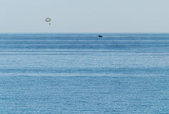 Parachute flight over the sea. Active rest, the boat rolls paragliders over the sea Royalty Free Stock Photos