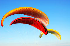 Parachute flying Stock Photos