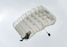 Parachute Flying high. A parachute in the air Stock Photo