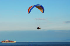 Parachute flying on sky Stock Photography