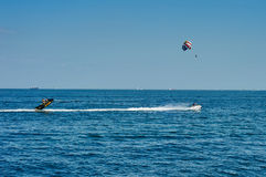 Parachute on the high seas. Odessa, Ukraine - August 31, 2015: Parachute on the high seas pulls watercraft on the sea. Parachute on the high. Parachute Royalty Free Stock Photo