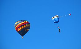 Parachute with Hot Air Balloon. Parachute in the Sky with Hot Air Balloon Royalty Free Stock Image