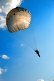Parachute jump. Single parachute jumper against blue sky background Stock Photography