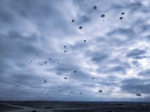 Parachute Jump military skydiving land battlefield cold autumn soldiers sky clouds parachute stock images