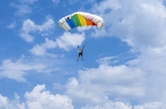 Parachute jumper in the air. Parachutist in flight with blue sky and clouds at the Red Bull Ordinul Smaranda competition on June 7, 2014 in Bucharest, Romania Stock Photography