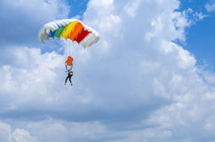 Parachute jumper in the air. Parachutist with colorful parachute in flight at the Red Bull Ordinul Smaranda competition on June 7, 2014 in Bucharest, Romania Stock Photography