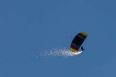 Parachute jumper with fire on legs Royalty Free Stock Image