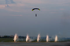 Parachute jumper with fire on legs Royalty Free Stock Photos